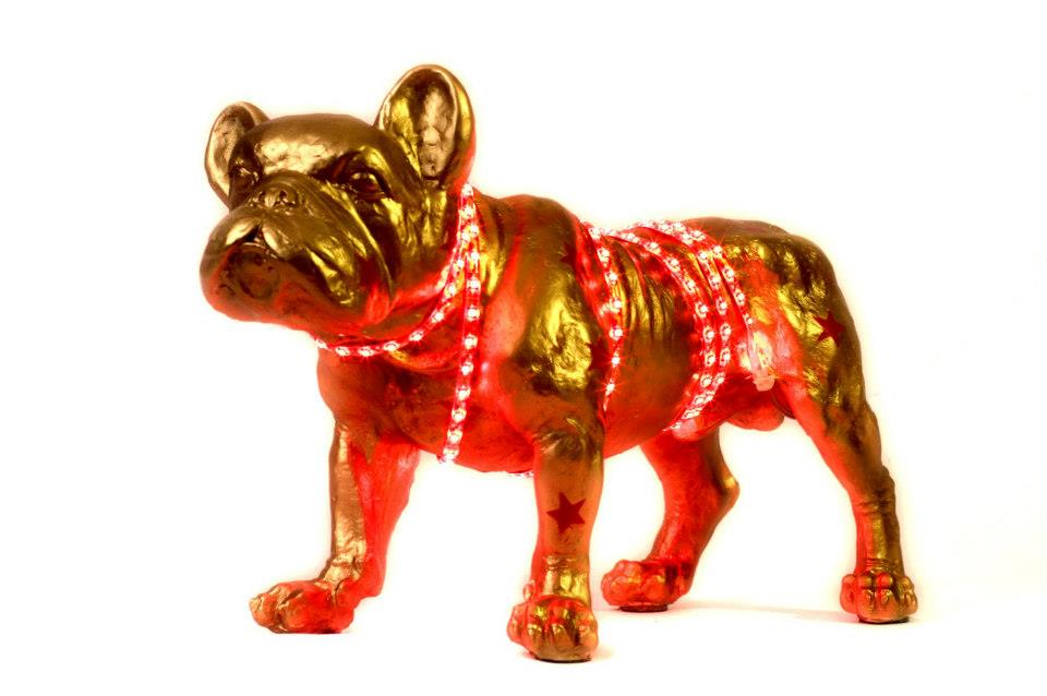 Golden and red sculpture of a French Bull Dog